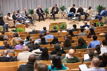 Chancellor Kevin Guskiewicz (center) and other campus leaders speak onstage in the Genome Sciences Building during the 2020 Summit on Safety and Belonging. The Summit addressed six key aspects of the campus climate, according to conversation and research: police behavior, sexual violence and danger, communications and Alert Carolina, physical safety, anti-racist activism and safety of marginalized communities.
