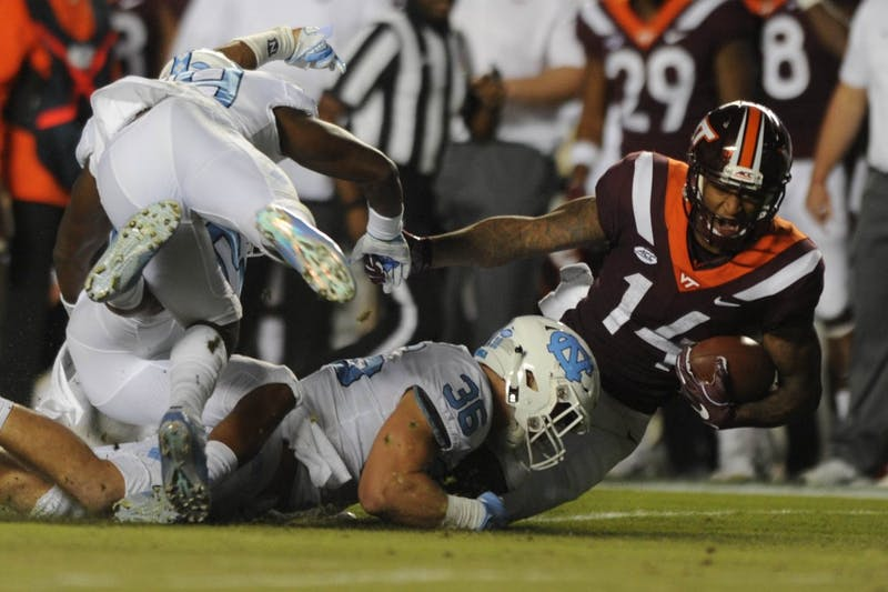UNC linebacker Cole Holcomb (36) tackles Virginia Tech wide receiver Damon Hazelton(14) in Kenan Memorial Stadium on Saturday, Oct. 13, 2018. Virginia Tech defeated UNC 22-19 with a touchdown and two point conversion in the final minutes of the game.