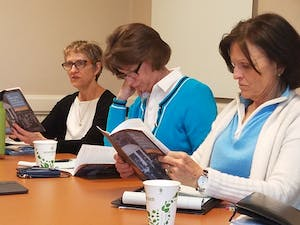University Government Committee members (from left to right) Anne Klinefelter, Joy Renner and Suzanne Gulledge review the wording in the Faculty Code. The University Government Committee met on Wednesday to discuss any possible changes to the Code.