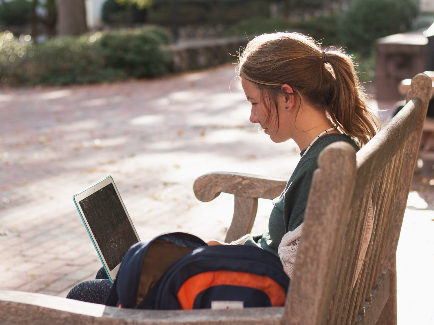 Rosie Robbins, a senior studying religious studies, sits outside on campus on Thursday, Oct. 31, 2019. Robbins is just one of many Carolina students entering the workforce with the looming possibility of a recession.