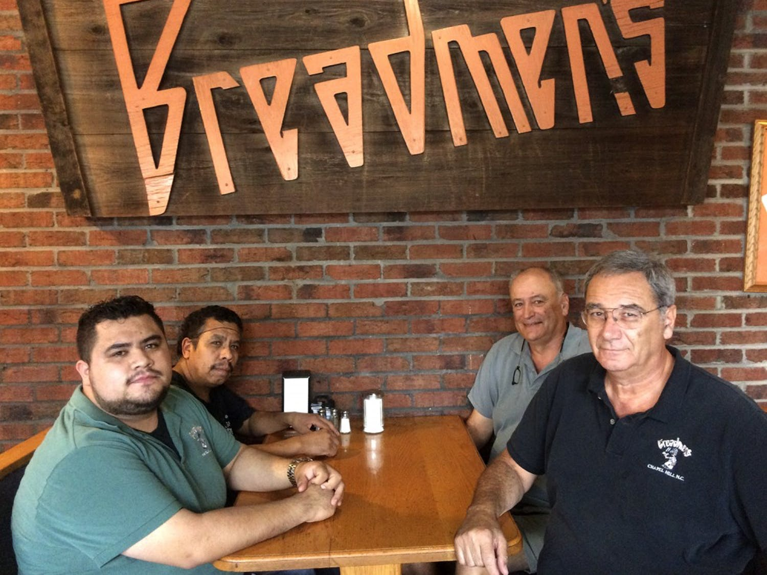 Breadmen's employees Omar Castro and Luz Castro, along with Bill Piscitello and Roy Piscitello, the owners of Breadmen's, pose together.