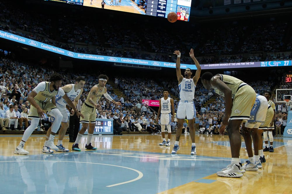 <p>UNC forward Garrison Brooks (15) shoots a free throw during the game vs Georgia Tech in the Smith Center on Jan. 4, 2020.</p>