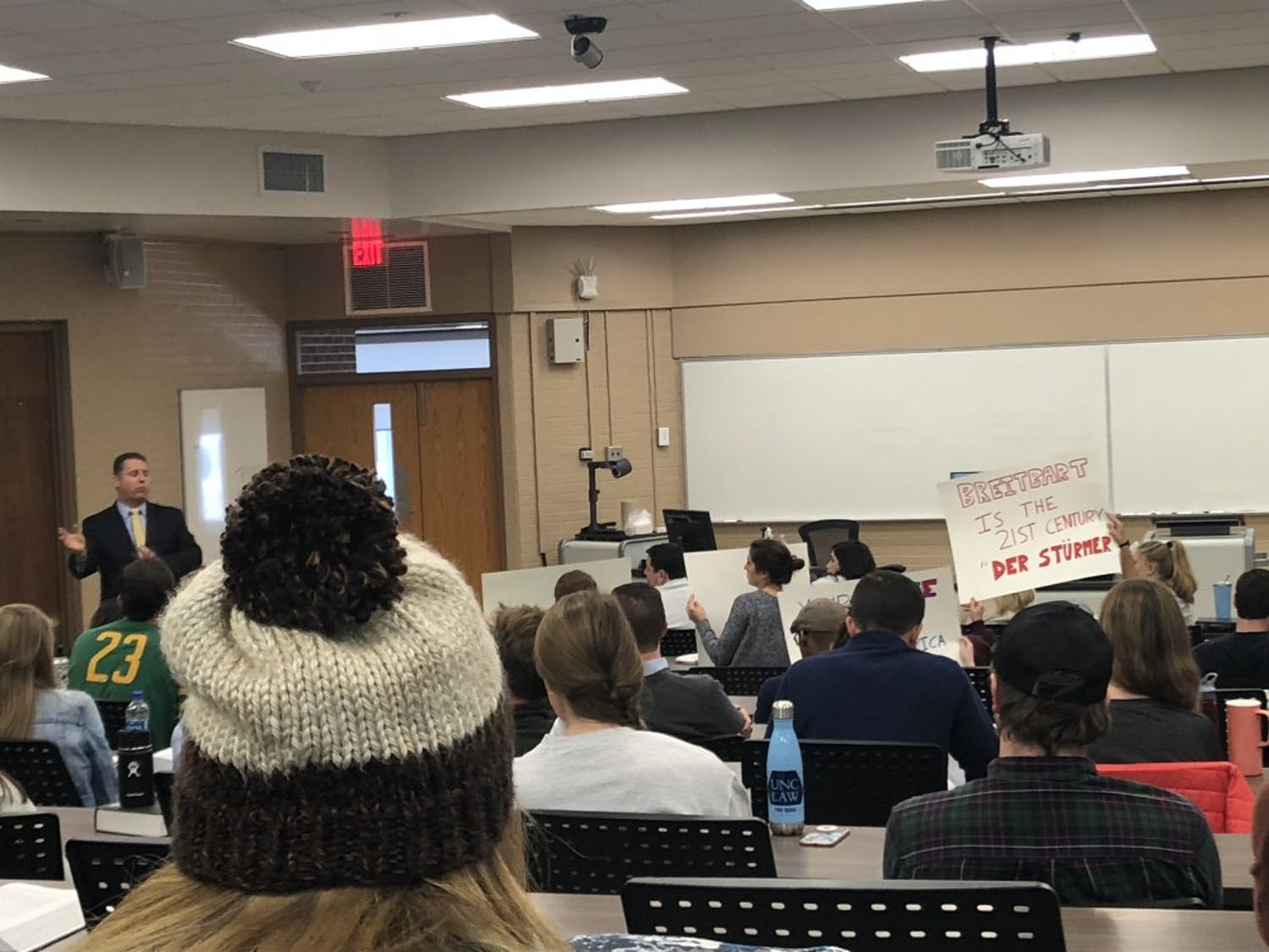 Ken Klukowski, senior legal editor for Breitbart New Network lectures at UNC School of Law amidst protests at noon on Tuesday.