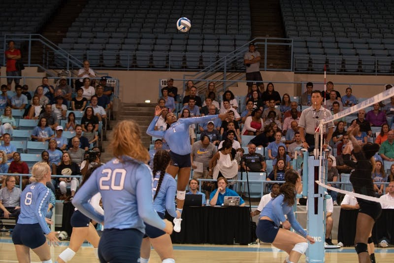Outside hitter Destiny Cox (1) leaps up for a spike against Michigan State in Carmichael Arena on Sept. 1.