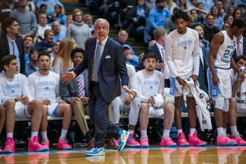 """Roy Williams participated in """"Suits and Sneakers Week"""" by wearing a special suit, tie and sneakers to the game against Virginia Tech to raise awareness for cancer."""