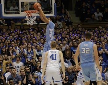 Cameron Johnson, who scored 26 points, jumps up for a dunk against Duke on Feb. 20, 2019. The Tar Heels won the rivalry game, 88-72.