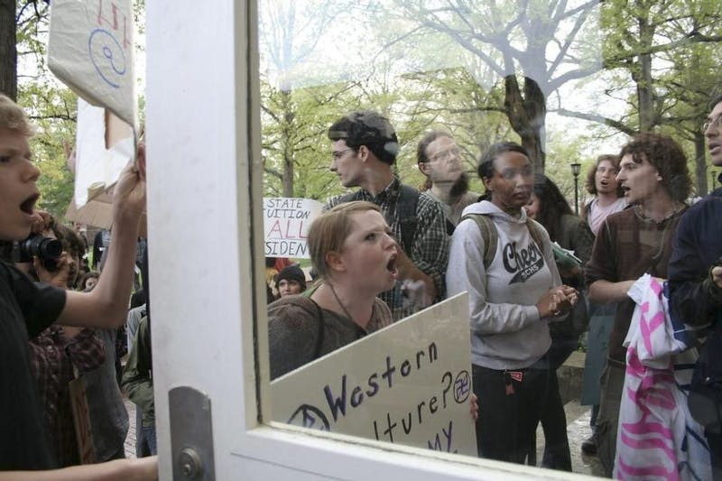 Protesters halted a speech by former U.S. Rep. Tom Tancredo at UNC in 2009. File Photo by Ariana van den Akker.