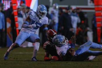 Wide receiver Dazz Newsome (5) is tackled during the game against NC State on Saturday, Nov. 30, 2019.