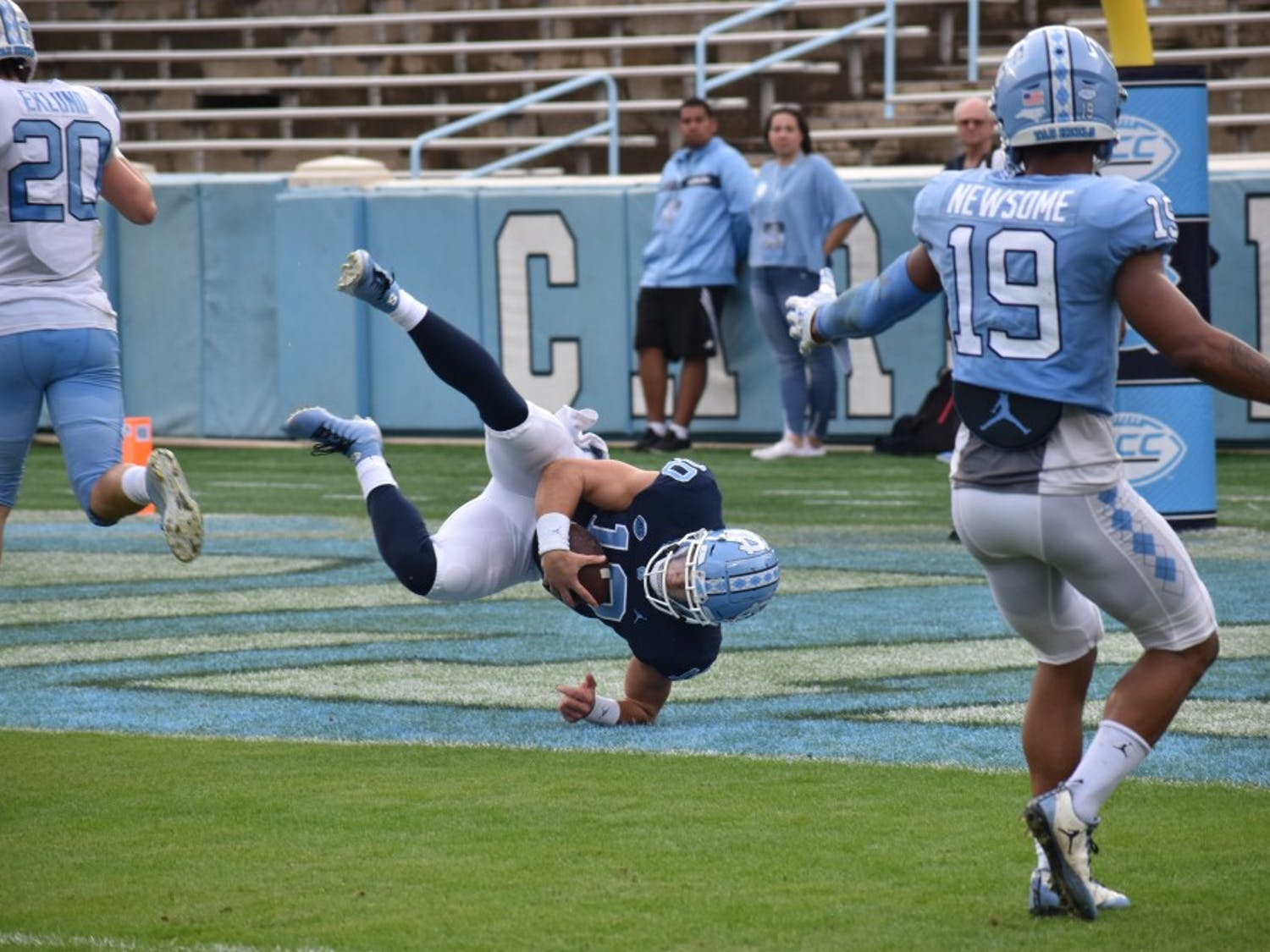 UNC first-year quarterback Jace Ruder (10) leaps into the end zone for a touchdown in the Spring Football Game on April 13, 2019 in Kenan Stadium. The Carolina team defeated the Tar Heel team 25-10.