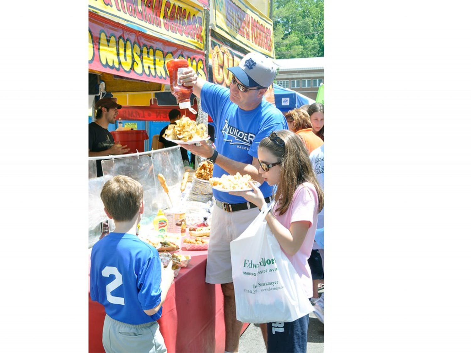 "UNC alumnus Chip Venable brings his kids, Preston and Hannah, to the festival every year. ""The kids really love it. They love the rides and the balloons and I like to have my barbecue,"" Venable said."
