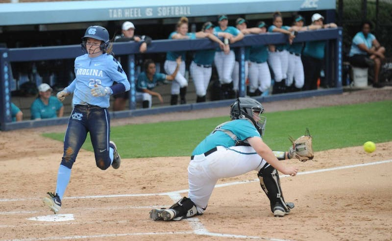 Senior outflieder Destiny DeBerry (22) reaches first base safely during the game against Costal Carolina University on Tuesday, April 9, 2019 at the Anderson Softball Stadium. UNC won 9-0 against Costal Carolina University.