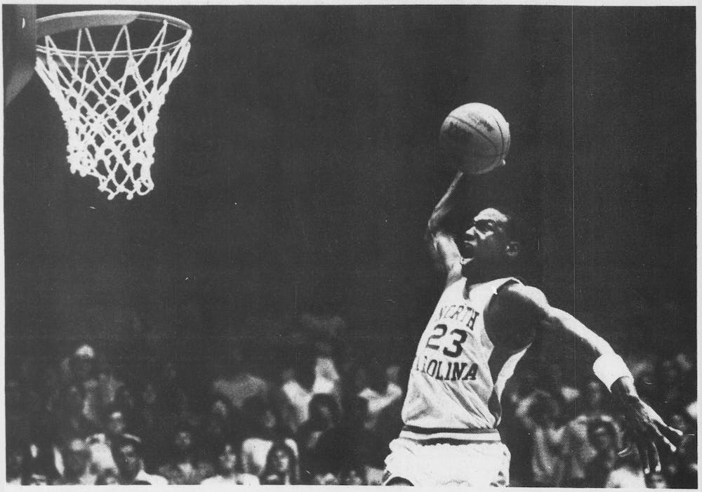 <p>North Carolina's Michael Jordan turned some smart talk from an opponent into 20 second-half points and an insurmountable lead as the Tar Heels rolled over Tennessee-Chattanooga before a capacity crowd in Carmichael Auditorium on Monday, Nov. 28, 1983. Photograph by Larry Childress from DTH Archives.</p>