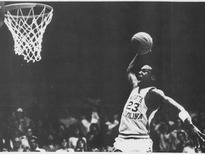 North Carolina's Michael Jordan turned some smart talk from an opponent into 20 second-half points and an insurmountable lead as the Tar Heels rolled over Tennessee-Chattanooga before a capacity crowd in Carmichael Auditorium on Monday, Nov. 28, 1983. Photograph by Larry Childress from DTH Archives.