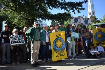 Participants of the Chapel Hill Climate Strike stand in the Peace and Justice Plaza in Chapel Hill on Friday, Sept. 20, 2019 to demand that the Chapel Hill Town Council calls for a national Green New Deal.