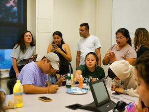 """On Monday, Sept.23, 2019 at the Carolina Latinx Center, students participate in """"Paint My Latinidad"""" by each painting a visual representation of their latinidad. This event was one of many hosted by the Carolina Latinx Center as a way to celebrate Latin Heritage Month and raise conversations about Latinx culture."""