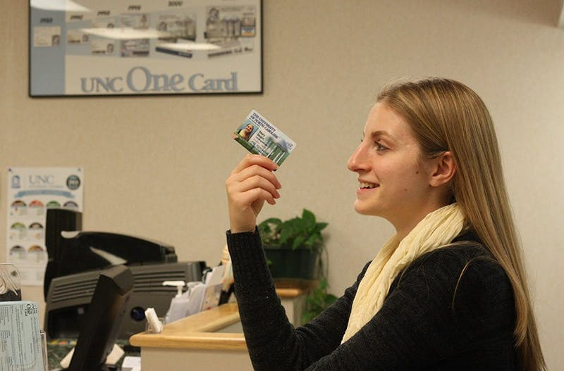 Mary Katherine Beam, a junior psychology major from Asheboro gets a new OneCard at the UNC One Card office on Monday afternoon.