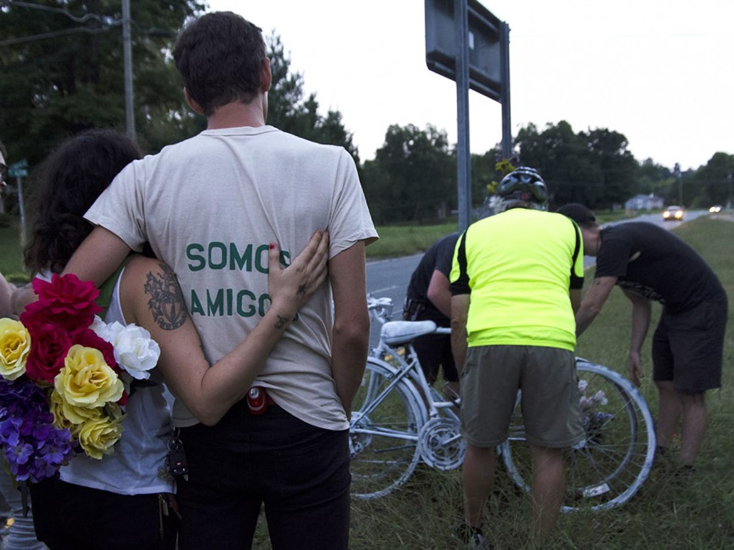 """A year ago on Friday, two cyclists were struck and killed on 15-501. In memorial, their friends painted two bicycles and rode out to the site to decorate them. Jason Merrill, from Back Alley Bikes, painted the two bicycles and helped to organize the ride. He explained that """"anytime cyclists are struck, it definitely hits close to home."""""""