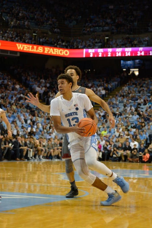North Carolina guard Cameron Johnson (13) drives towards the basket during Tuesday night's game against Boston College.