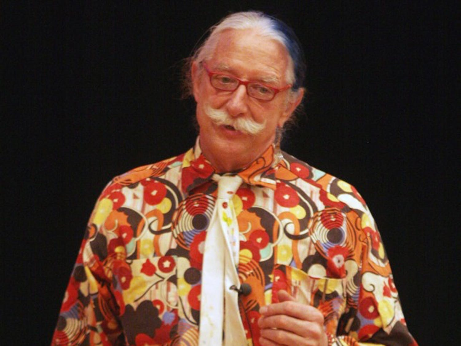 Patch Adams recites A Lemon by Pablo Neruda as he explains his his love strategy in the Great Hall Wednesday.