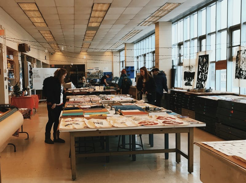 Visitors check out student artwork at the 2018 Print + Art Sale. Photo courtesy of Luke Collins.