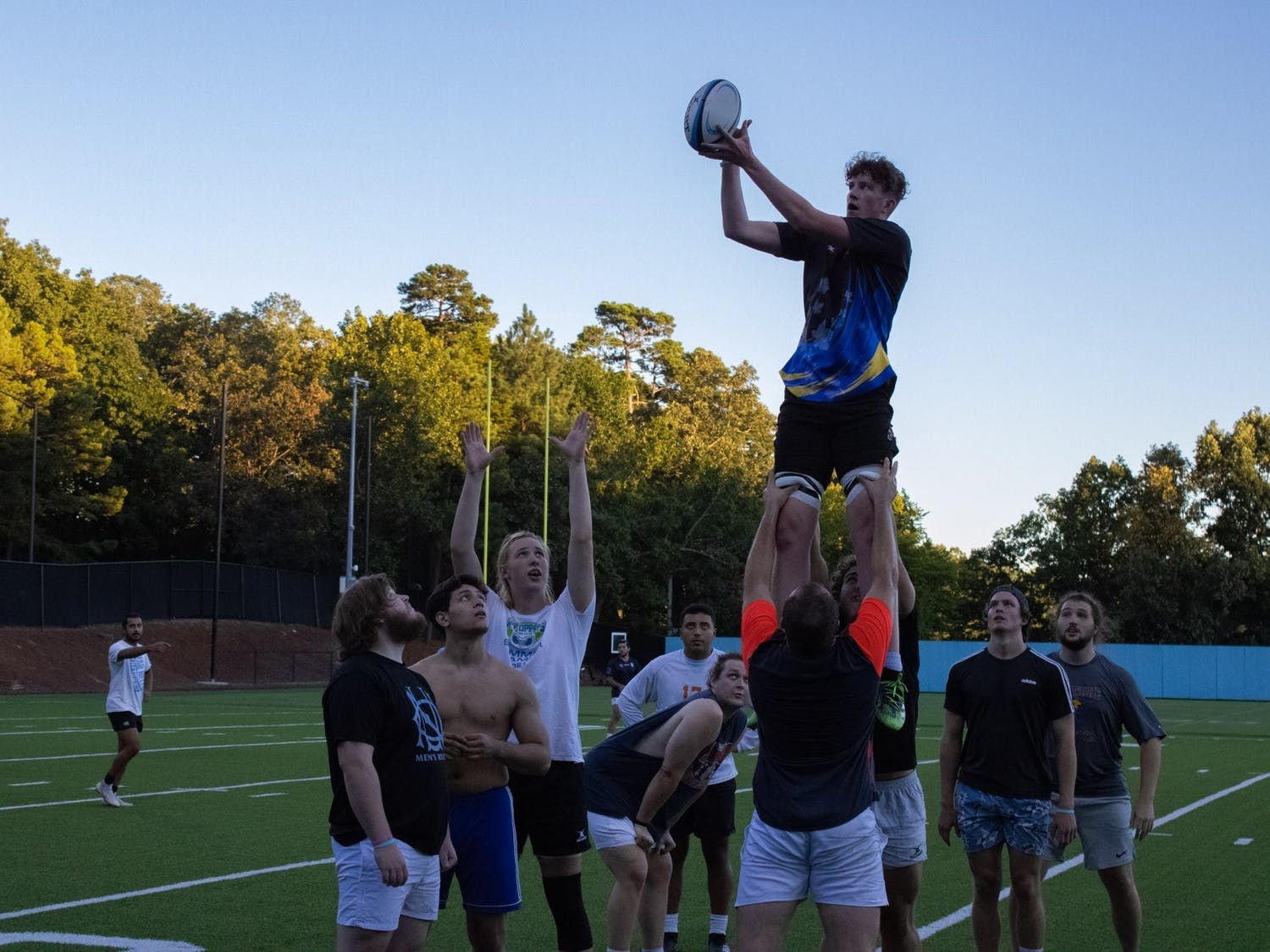"""Sophomore Club Player Matt Warren catches the ball in a lineout at the UNC-CH Men's Rugby Football Club practice on Sept. 23. When asked about his time on the team, Warren responded, """"it gives guys community and family."""""""