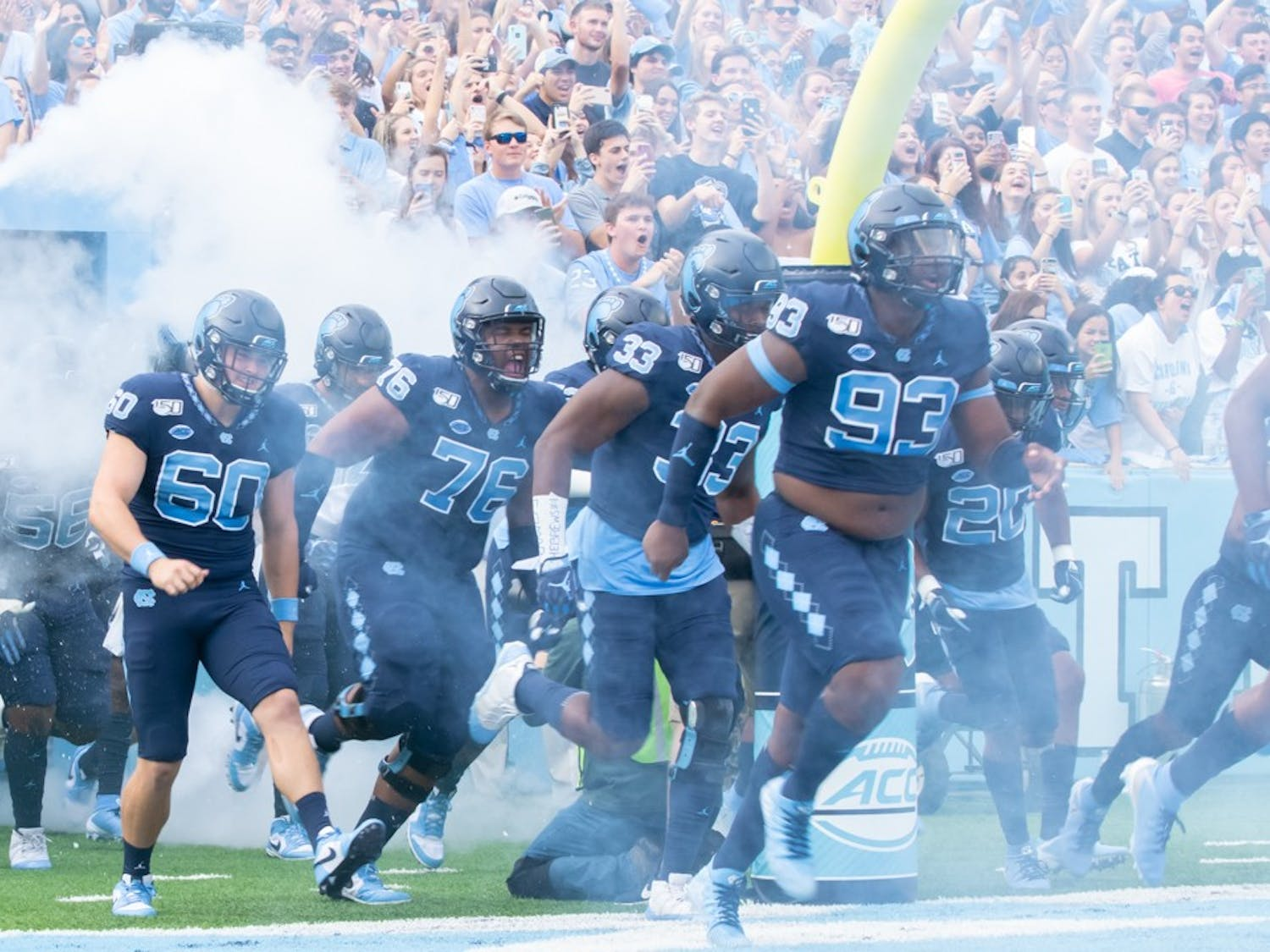 The UNC football team runs out of the tunnel before the game against Duke on Oct. 26, 2019. UNC went on to beat Duke 20-17.