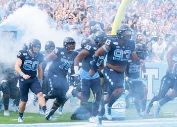 The UNC football team runs out of the tunnel before the game against Duke on Saturday, Oct/ 26, 2019. UNC went on to beat Duke 20-17.