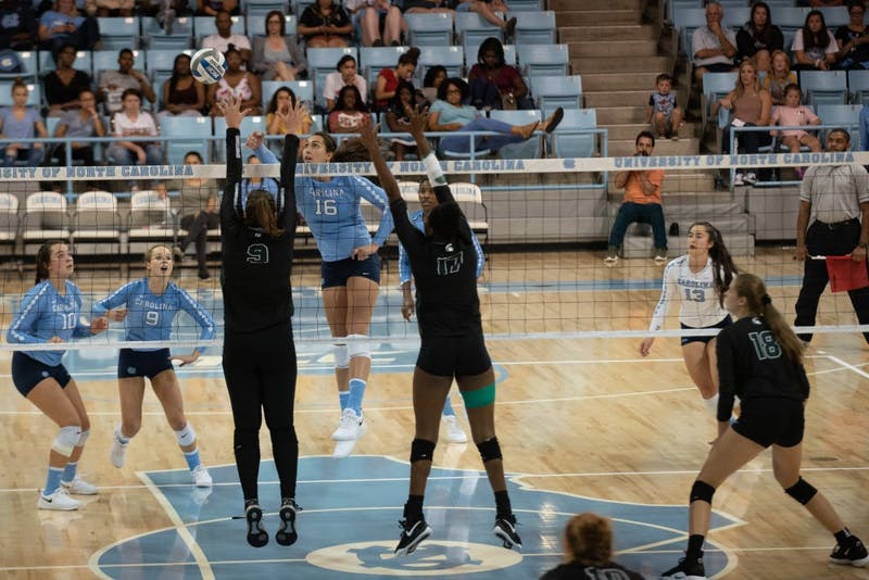 Middle hitter Raleigh Clark (16) goes for a kill against Michigan State during a 3-1 loss on Sept. 1 in Chapel Hill.