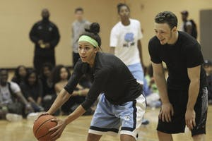 Sophomore point guard Jessica Washington and Keegan Pace, a senior philosophy major, play during a charity game to benefit the Josh Level Foundation.