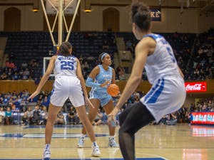 UNC junior center Janelle Bailey (30) moves to pass the ball. The Tar Heels lost against Duke 61-71 in Cameron Indoor Stadium on Thursday, Feb. 6, 2020.