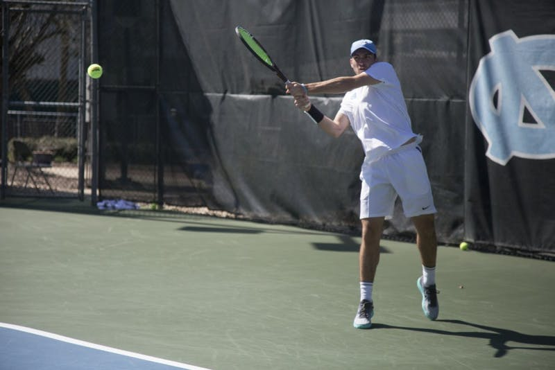 Junior Will Blumberg hits a backhand against Miami on Sunday, March 24 2019 at Cone-Kenfield Tennis Center. UNC defeated Miami 4-1.