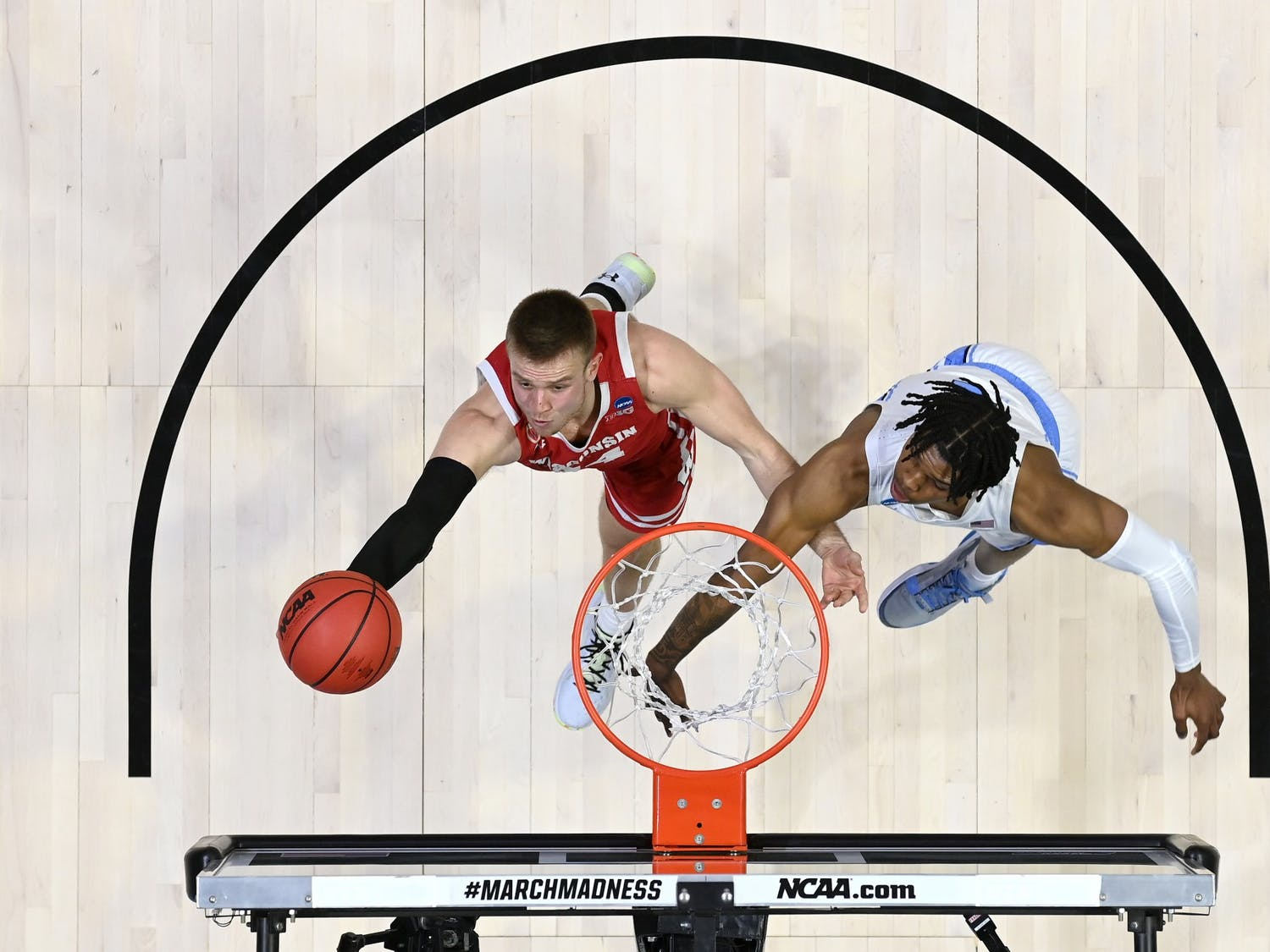 WEST LAFAYETTE, IN - MARCH 19: Brad Davison of Wisconsin works to get a shot past Caleb Love of North Carolina in the first round of the 2021 NCAA Division I Men's Basketball Tournament held at Mackey Arena on March 19, 2021 in West Lafayette, Indiana. Photo by Andy Hancock/NCAA Photos/NCAA Photos via Getty Images