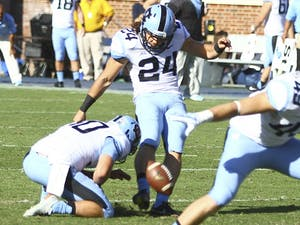 North Carolina kicker Nick Weiler (24) makes a field goal attempt. He is fighting for a starting spot.