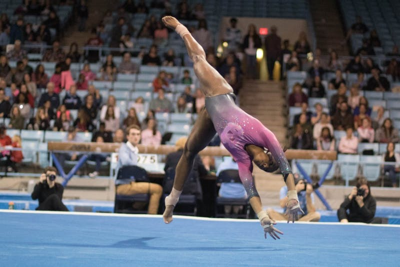 Khazia Hislop performs her floor routine during home opener and annual Women's Day and Pink Meet against Oklahoma and Ball State on Saturday, Jan. 19, 2019. UNC placed second behind Oklahoma.