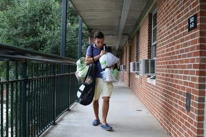 A first-year student moves into his dorm room in Hinton-James.