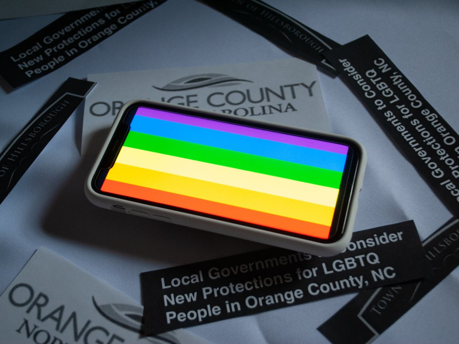 DTH Photo Illustration. Local governments met to discuss protections for LGBTQ+ people in Orange County.