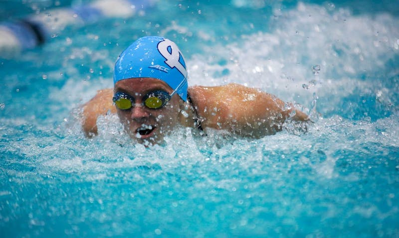 Mary-O Soule swims butterfly during the home meet against Virginia in Koury Natatorium on Friday, Jan. 25, 2019.  Both women and men lost to Virginia.