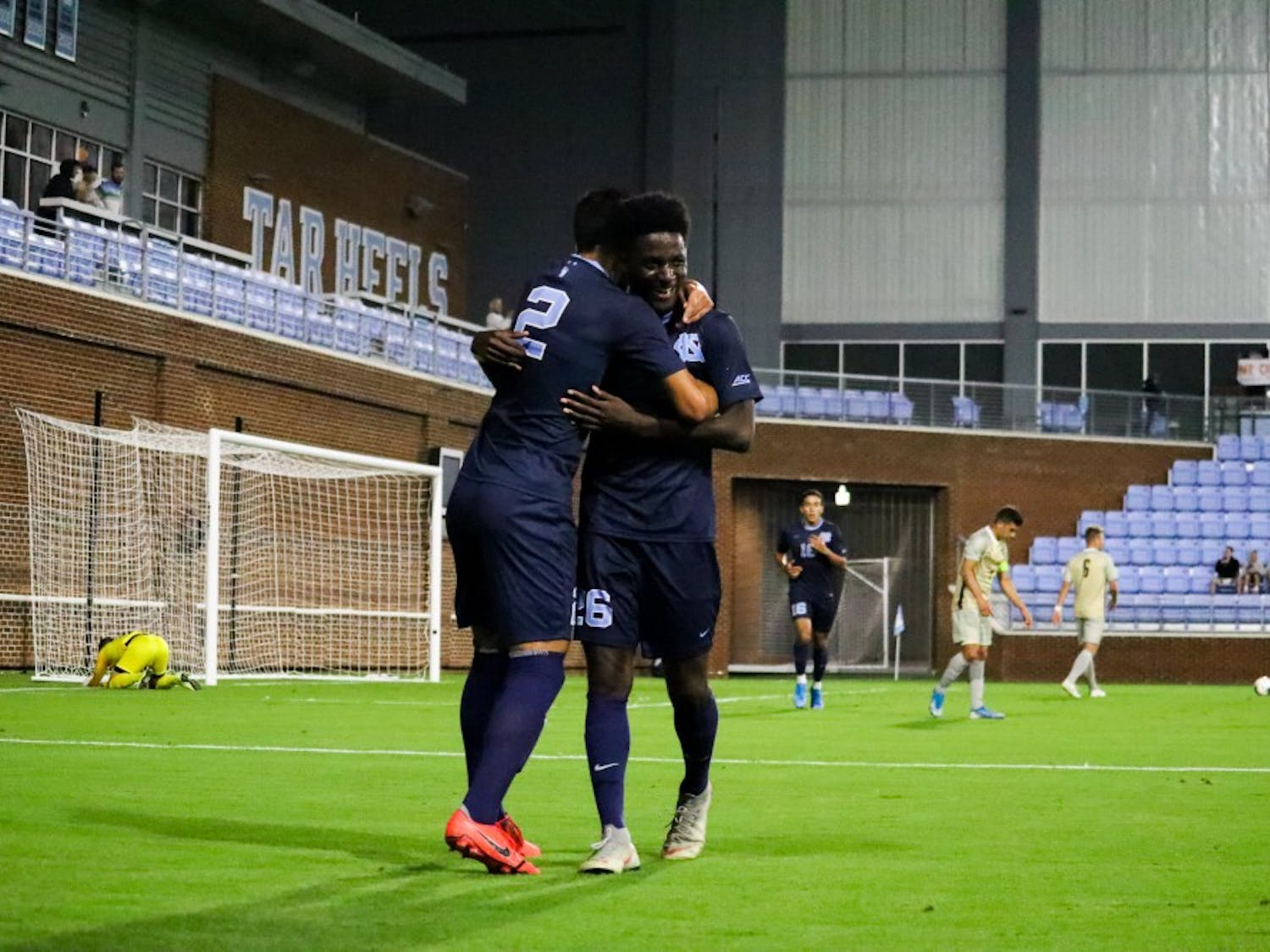 Senior midfielder Mauricio Pineda (2) celebrates his second goal in the first half with senior forward Jelani Peters (26). Pineda scored the first two goals in the Tar Heels 3-1 win over West Virginia on Tuesday, Oct. 8, 2019.