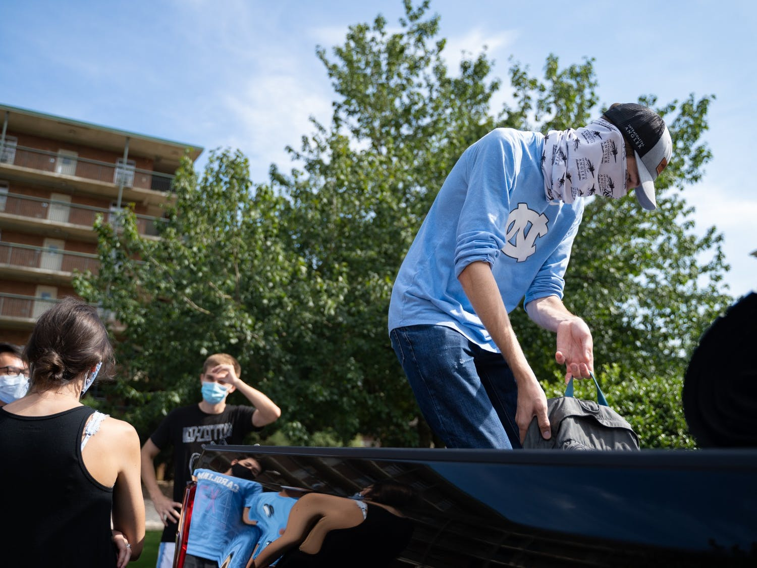 A first-year previously living in Craige Residence Hall moves out with the help of his suitemates on Tuesday, Aug. 18, 2020 following UNC's announcement that all classes will be moving to an online format.