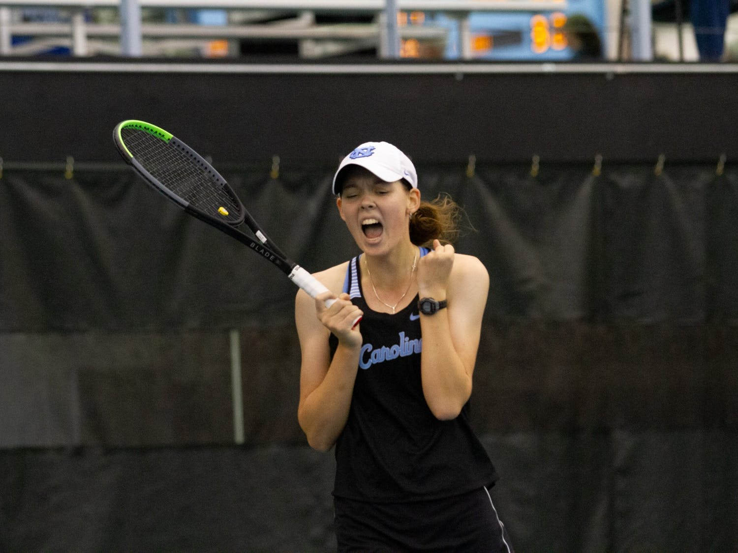 First-year Elizabeth Scotty shouts in celebration after successfully scoring a point during her singles match against Old Dominion University during the ITA Championship hosted at the Cone-Kenfield Tennis Center in Chapel Hill, NC, on Saturday, January 25th. The Tar Heels went on to win the championship  4-1 against Old Dominion University.