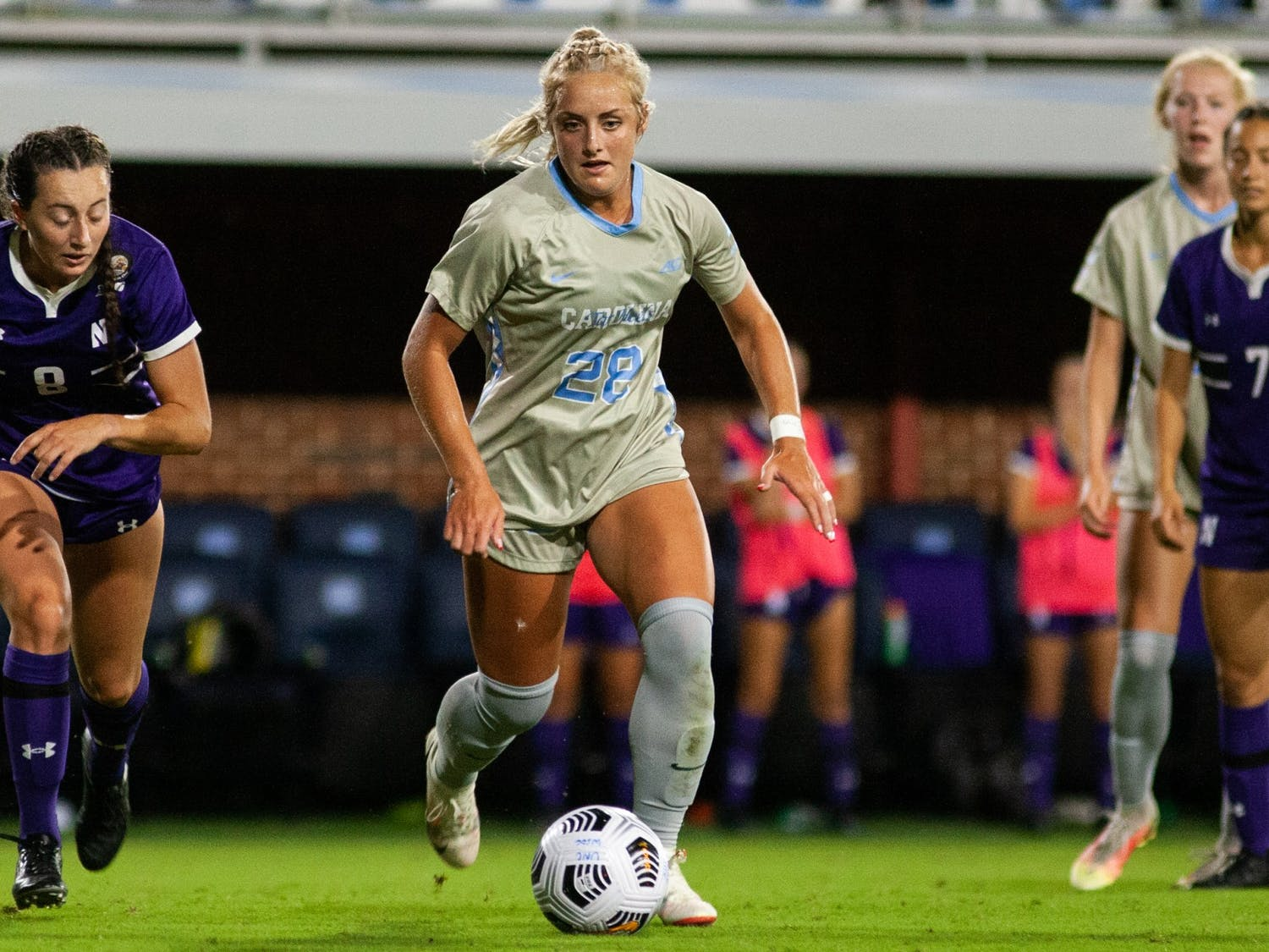 Junior midfielder Maddie Pierce (28) moves the ball down the field at the home game against Northwestern on Sept 2. UNC won 2-0.