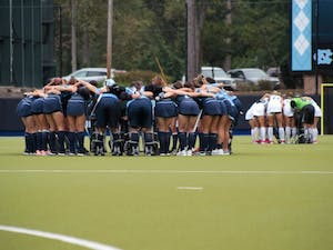 The UNC field hockey team huddles together on Sunday Sept. 15, 2019, before playing William and Mary. UNC won 8-0.