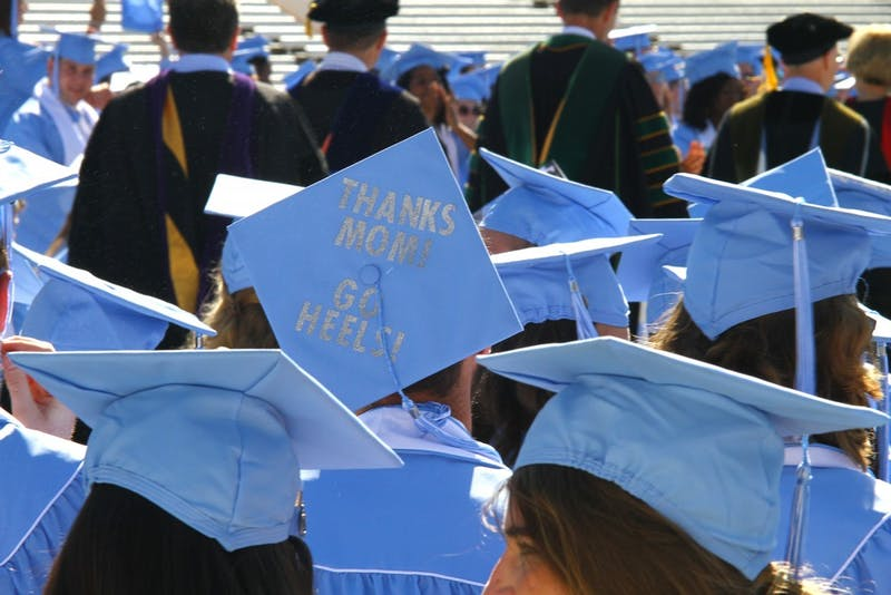 Graduates decorated their caps for the ceremony, many giving shootouts to their moms on Mother's Day.