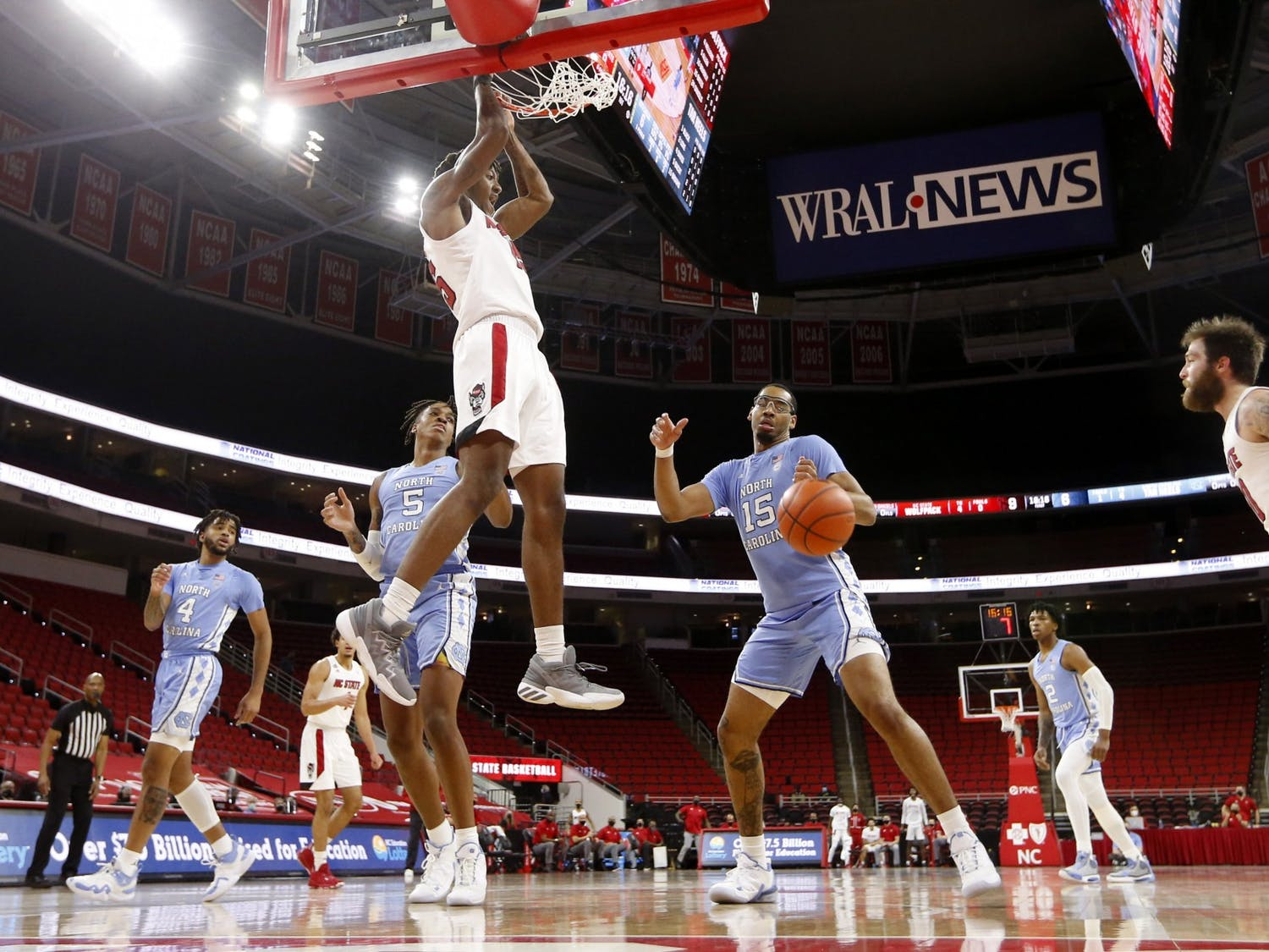 N.C. State's Manny Bates (15) slams in two during N.C. State's 79-76 victory over UNC at PNC Arena in Raleigh, N.C., Tuesday, December 22, 2020. Photo courtesy of Ethan Hyman.