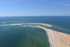 A new island started forming off the coast of Cape Point in the Outer Banks last fall. The sandbar, named Shelly Island, was found to be connected to Hatteras Island. Photo courtesy of outerbanks.org.