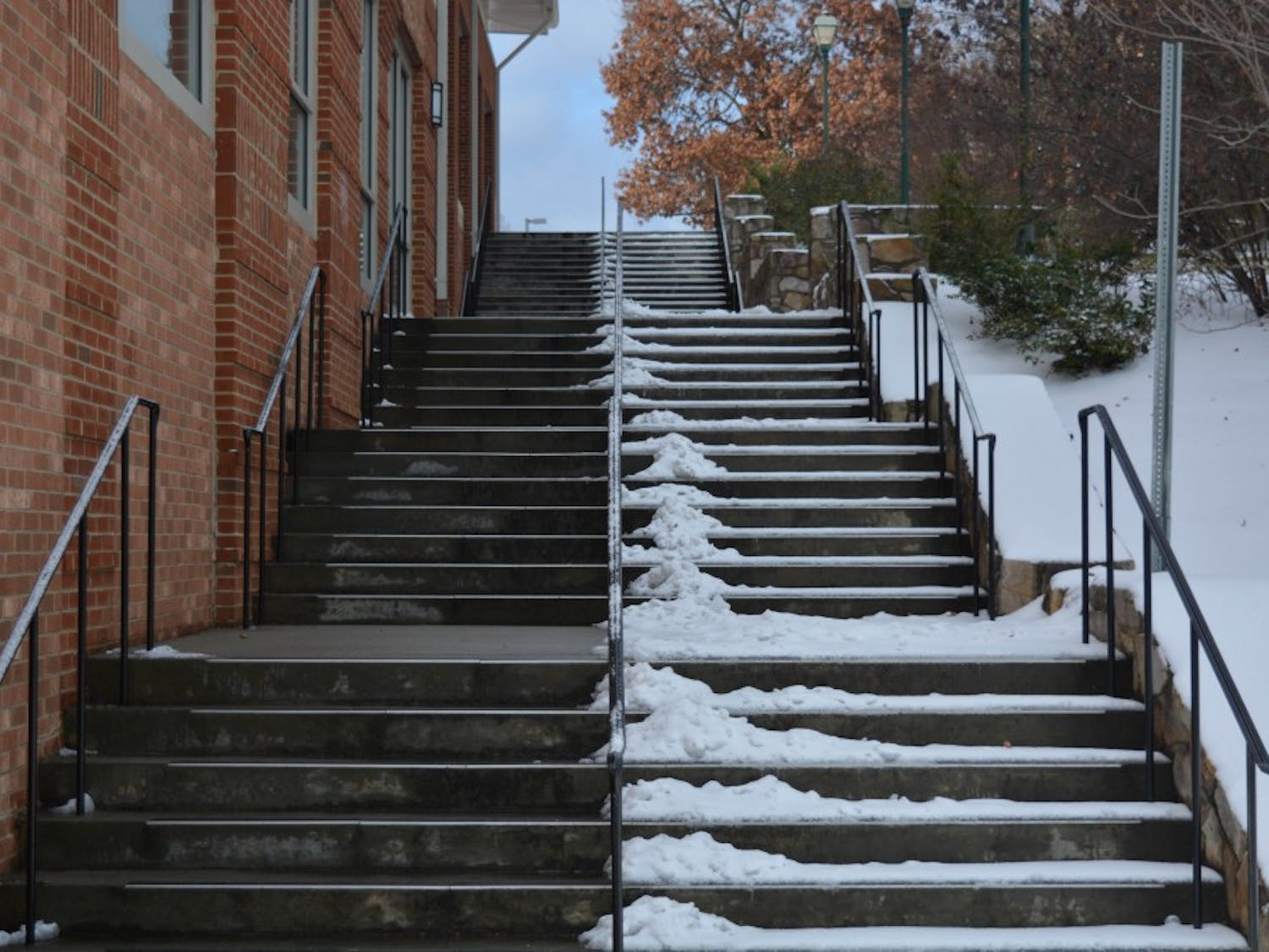 Workers spent the afternoon clearing pathways across campus to make it safe for walking.