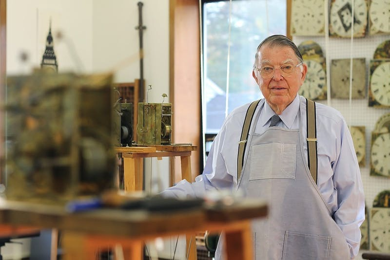 Dick Spangler stands in his workshop in Charlotte where he restores antique grandfather clocks.
