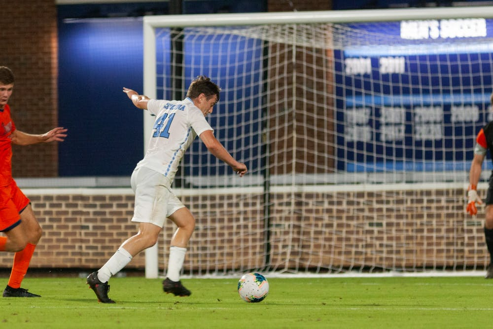 UNC graduate midfielder Chris Sullivan (41) attempts a goal at the game against Bucknell on Thursday, August 26th, 2021 at Dorrance Field in Chapel Hill. The Tar Heels won 7-0.