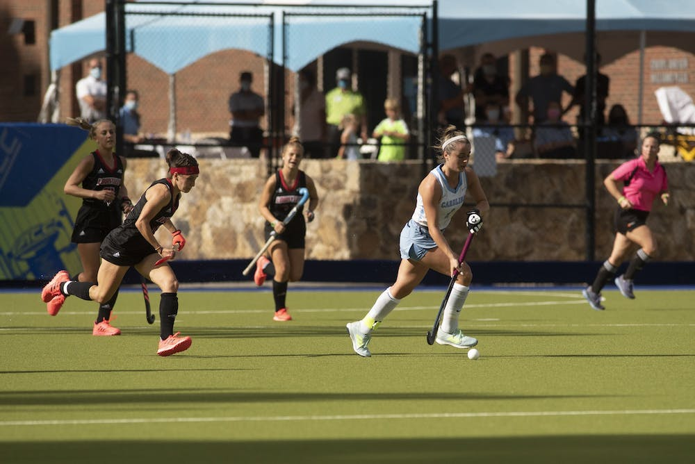Junior forward Erin Matson (1) drives the ball up the field during the ACC Field Hockey Championship game against Louisville in Karen Shelton Stadium on Sunday, Nov. 8, 2020. Matson scored two of Carolina's four goals. Carolina defeated the Cardinals 4-2, securing their fourth consecutive tournament title.