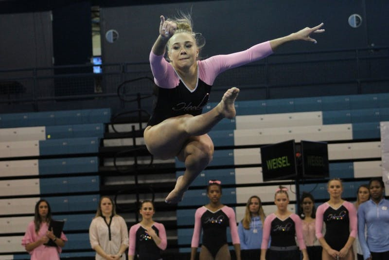 Senior Lauren Weisel competes against Brown in the North Carolina gymnastics team's meet on Feb. 19 on Carmichael Arena.